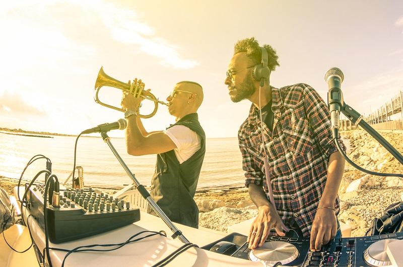 DJ with sound system on summer beach