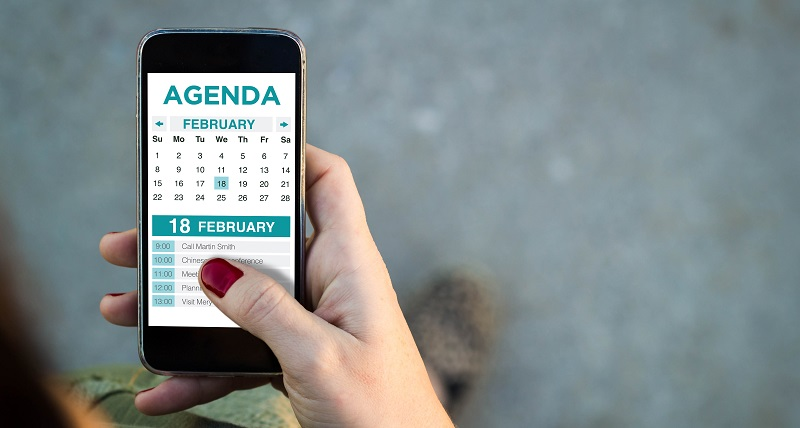 Woman receiving push notifications of event schedule